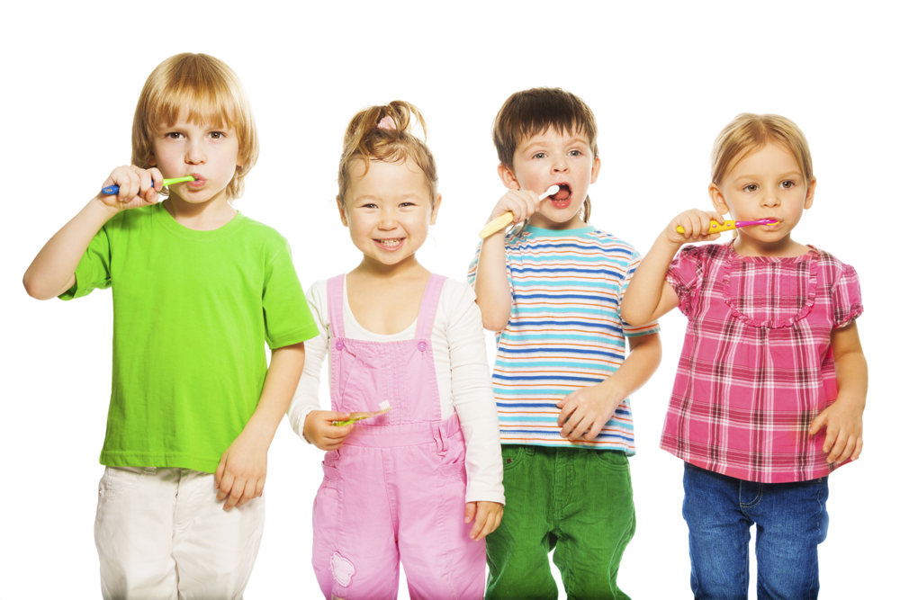 four kids brushing their teeth | Omaha Dentistry