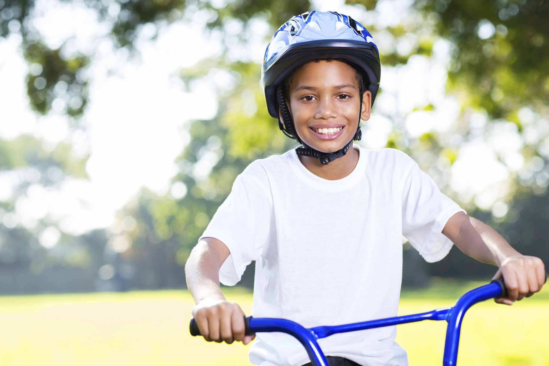 Boy on a bicycle | summer safety and dental health