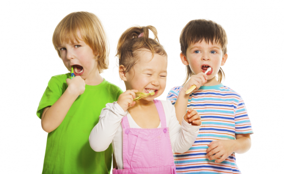 Three children brushing their teeth | Kids Club | Omaha Dentistry