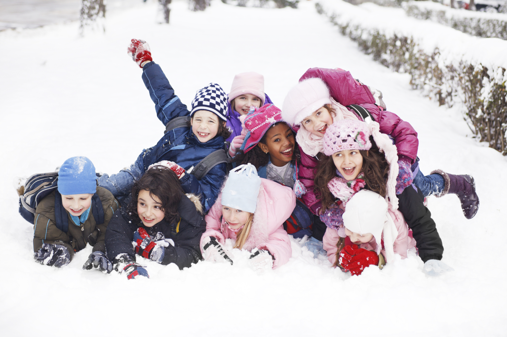 Children playing in the snow | Winter Safety and Dental Health.